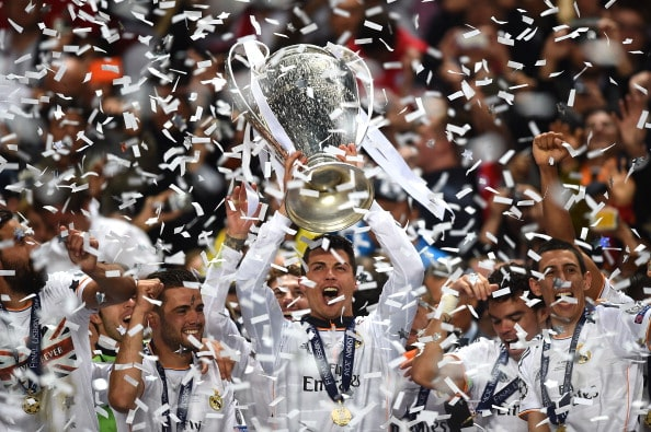 LISBON, PORTUGAL - MAY 24: Cristiano Ronaldo of Real Madrid lifts the Champions league trophy during the UEFA Champions League Final between Real Madrid and Atletico de Madrid at Estadio da Luz on May 24, 2014 in Lisbon, Portugal. (Photo by Laurence Griffiths/Getty Images)