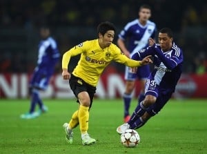 DORTMUND, GERMANY - DECEMBER 09: Shinji Kagawa of Borussia Dortmund is closed down by Youri Tielemans of Anderlecht during the UEFA Champions League Group D match between Borussia Dortmund and RSC Anderlecht at Signal Iduna Park on December 9, 2014 in Dortmund, Germany. (Photo by Dennis Grombkowski/Bongarts/Getty Images)