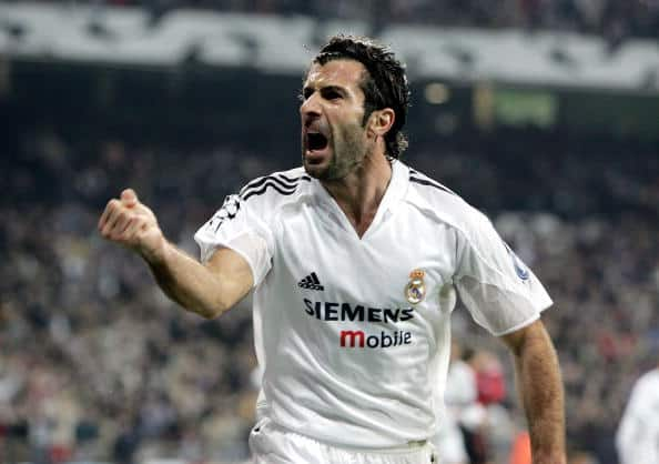 MADRID, SPAIN - NOVEMBER 23: Luis Figo of Real Madrid celebrates the equaliser scored by Raul during the UEFA Champions League Group B match between Real Madrid and Bayer Leverkusen, held at The Santiago Bernabeu Stadium on November 23, 2004 in Madrid, Spain. (Photo by Richard Heathcote/Getty Images)