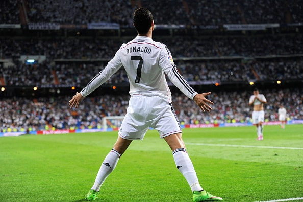 MADRID, SPAIN - OCTOBER 05: Cristiano Ronaldo of Real Madrid celebrates after scoring his team's 5th and his third goal against Club Athletic during the La Liga match between Real Madrid CF and Athletic Club at Estadio Santiago Bernabeu on October 5, 2014 in Madrid, Spain. (Photo by Denis Doyle/Getty Images)