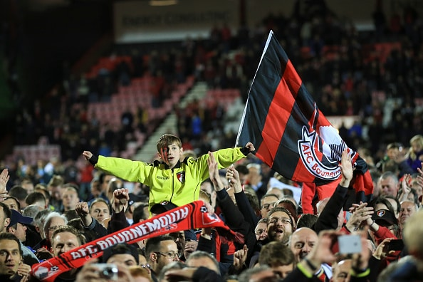 BOURNEMOUTH, ENGLAND - APRIL 27 : Bournemouth fans celebrate promotion to the premier league with a pitch invasion during the Sky Bet Championship match between AFC Bournemouth and Bolton Wanderers at Goldsands Stadium on April 27, 2015 in Bournemouth, England. (Photo by Marc Atkins/Mark Leech/Getty Images)
